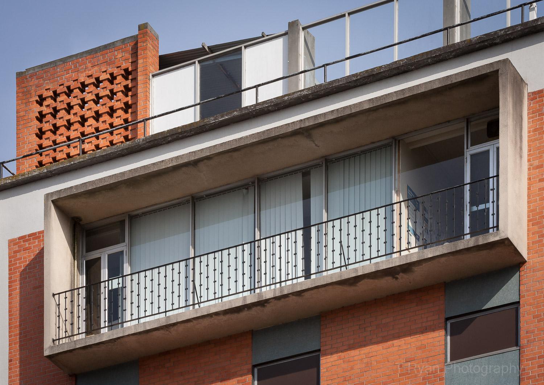 The concrete veranda ''tv box'', the railing and brickwork details are all original period designs of 1960s architecture