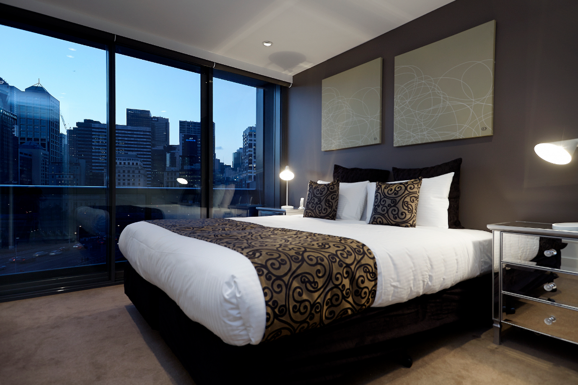 freshwater place third bedroom with split king bed, bathroom and balcony