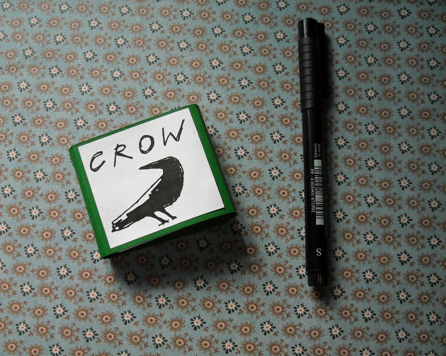 "crow - I made this small accordion book about 15 years ago but it has recently been read from (and described in words) on BBC Radio 4's Short Cuts in the episode ""Crow"" featuring Christina McLeish, so I have put up some images.I wrote it while living in a tiny cabin in Cornwall. The back window looked out onto a golf course and I spent a lot of time observing the crows that frequented it."