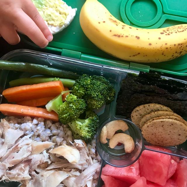 Buckwheat + chicken, carrot + broc, watermelon, cashews, rice crackers, nori, banana, rice cake w/avo. -