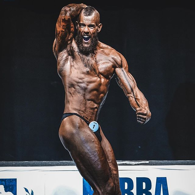 The NABBA British Finals. I placed 5th and that's an achievement I'll always have but it definitely wasn't worth the toll it took on my mental health.  On stage I was in the best physical shape of my life but the worst mental shape, and I'll be diving deeper into it in an upcoming video project called (Mental) Health and Fitness.  For all the photos from the show go to jesuishench.com . . . . . #mentalhealth #bodybuilding #bodybuilder #pose #determination #motivation #gym #beardstrength #strength #muscle #muscular #anger #depression #anxiety #youcandoit #transformationtuesday