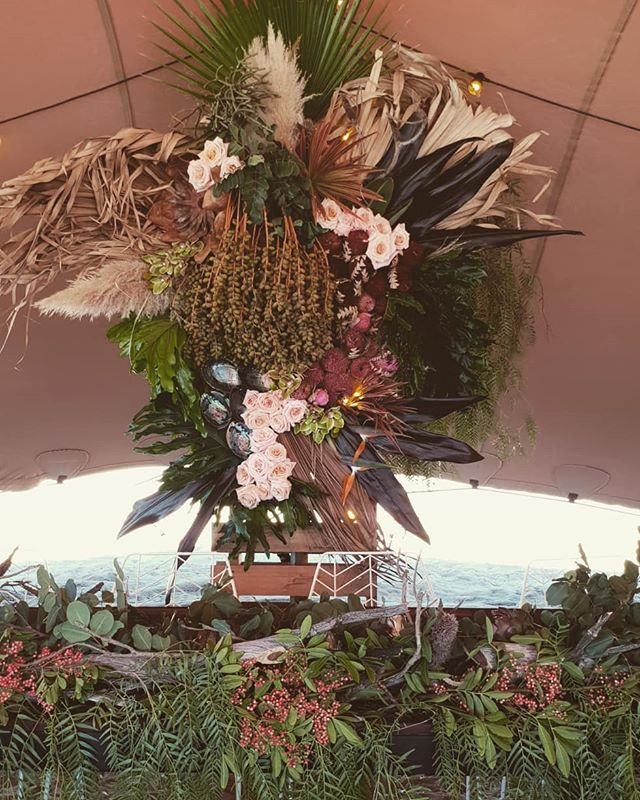 This bridal table installation featured a total mix of botanica from totally different climates, three huge regions of WA and a distance spanning 1600km apart. With subtropical, desert,  wheatbelt and southern forest specimens it really was a diverse collection. There was Palms from my friends garden in Exmouth, grasses from Carnarvon and then a car load of South West goodies that my floral stylists drove up to the middle of nowhere for this EPIC wedding. We also made use of the materials on hand at the farm #banksia sticks created  minimal modern table decor. Swipe left to see the details.  #lararosebotanicalstylist #floralinstallation #foamfree #seasonalfloweralliance #slowflowers #bushwedding #slowflowersaustralia #love #birdofparadise #carob #sheok #firestick #palm #driedflowers #palmflowers #desertwedding  #tropicalinstallation