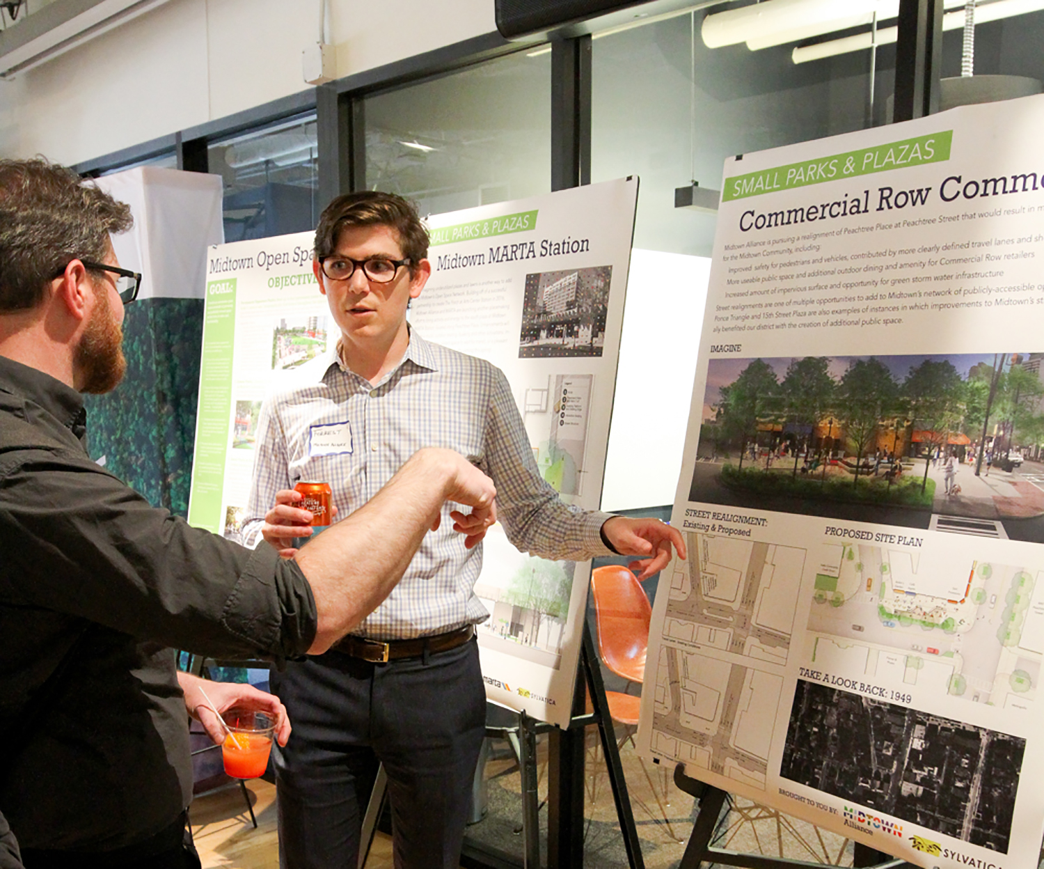 Midtown Alliance project manager for transportation Forrest Rose engages with a Midtown community member at a public informational meeting.