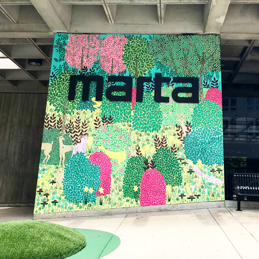 """""I must have flowers, always and always."" — Claude Monet 🙌🏻 completely charmed by the colorful environmental art installation  @midtown_atl  MARTA station. Chloe is too 🐶🎨🌸🌼🌳"" – @   designmemoir"