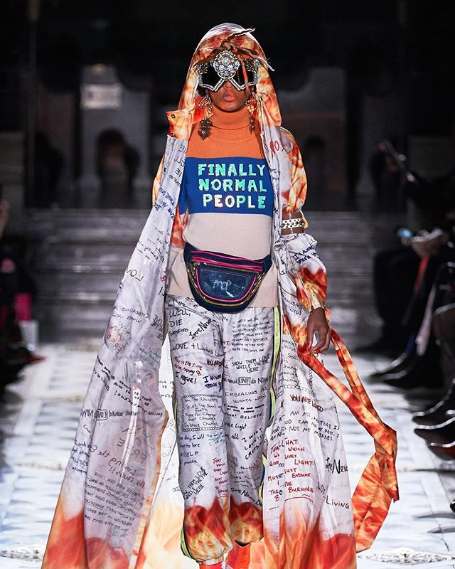*PFW Report* @manisharorafashion unveils a cultural masterpiece at his Paris FW19 collection. Inspirational messages, psychedelic florals, and ornate headdresses were seen across the looks with inspiration from multiple cultures- Navajo, Indian, Tribal, and Americana. This future forward designer shows us the beauty in celebrating the world's many cultures. What cultures inspire your style? PC: @vogueparis #manisharora #pfw19 #parisfashionweek2019 #parisfashionweek #fashionweek  #fashion #style #chic #vogue #aftervoguevoices #fw19