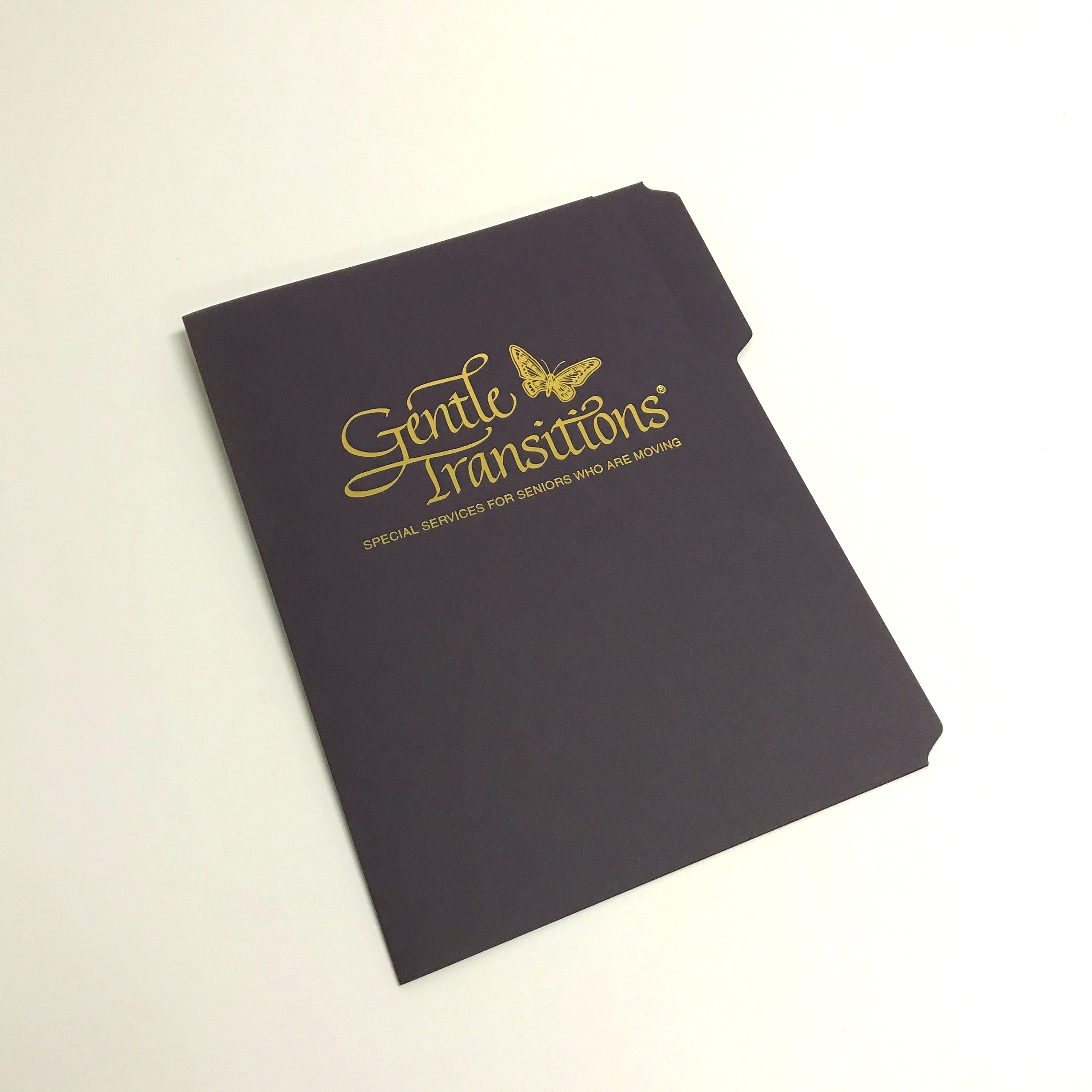 Unique die cut and foil stamped folder for corporate use printed in Minnesota