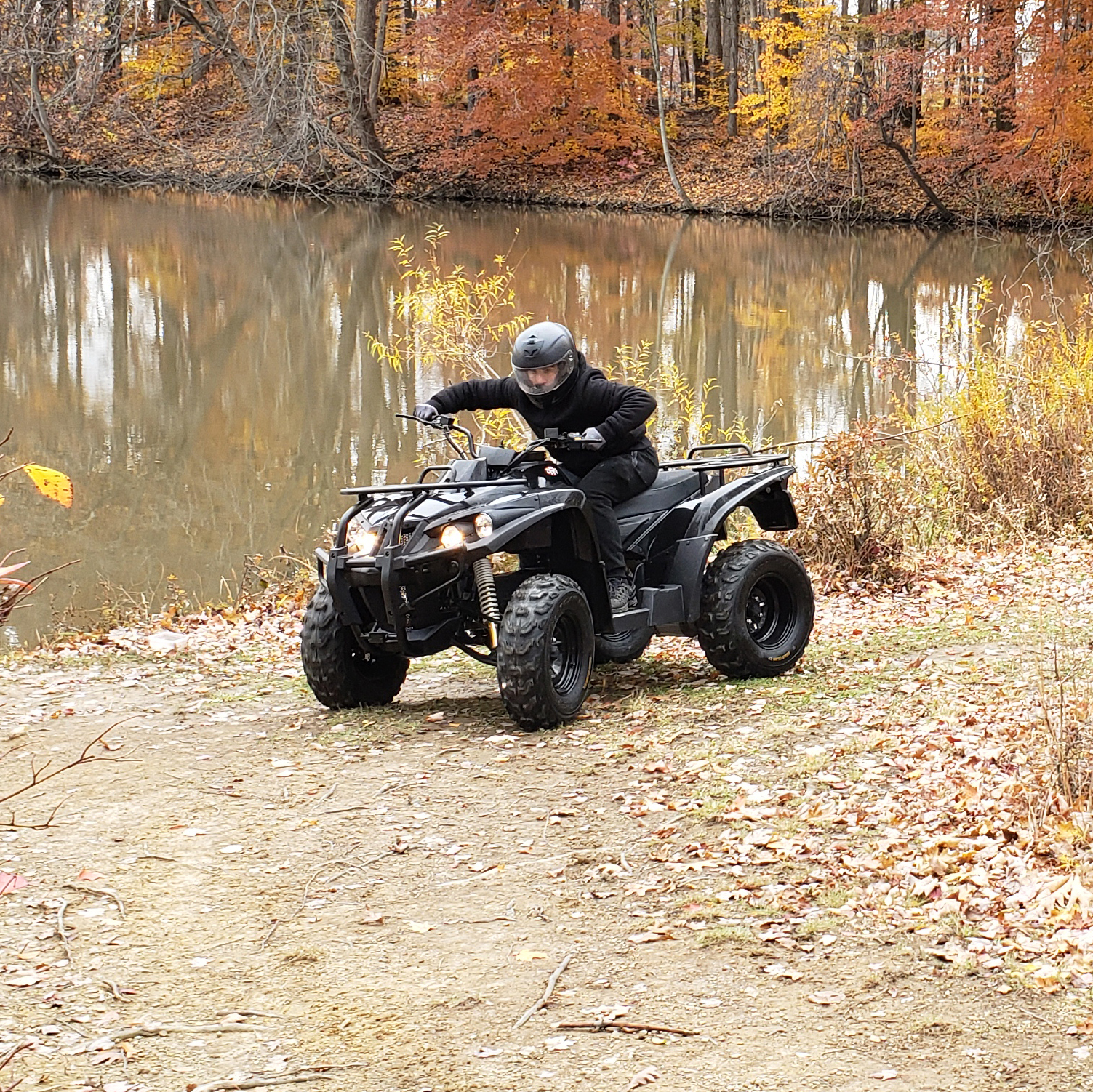 DRR USA Electric ATV in Fall by Lake Environmentally Friendly.jpg