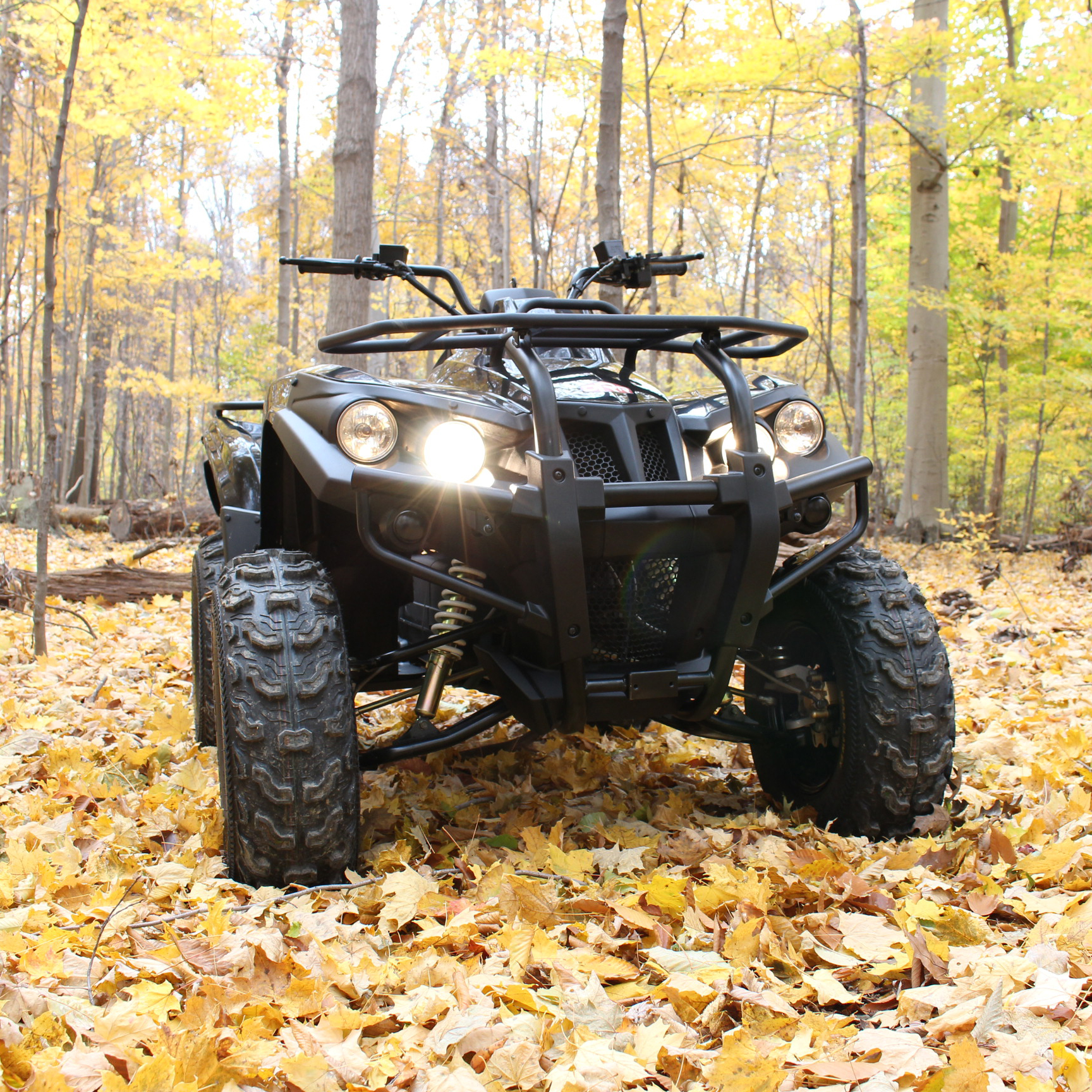 DRR USA Stealth Electric ATV silent in the woods in fall.jpg
