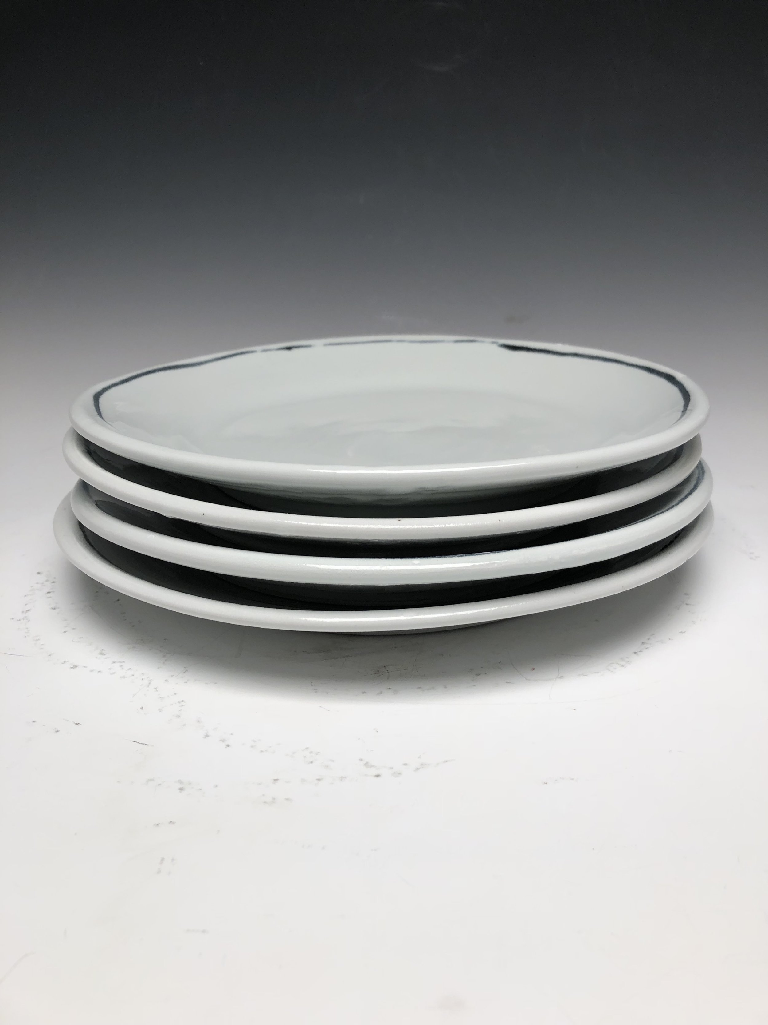 10 inch porcelain dinner plate. White with deep blue black line.