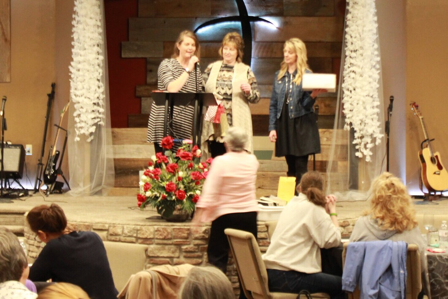 The Girls presenting one of the many door prizes given at the event
