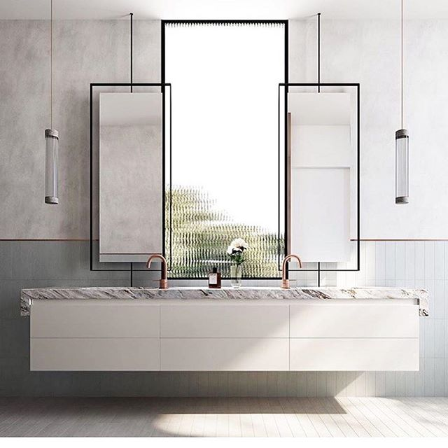 I love this bathroom's symmetrical minimalism. The vanity, suspended three-dimensional mirrors, and low-hanging light fixtures create a light, floating sensation. A perfect place for one's cleansing rituals! #lookswelove #interiordesign #melbourne #bathroom #home ⠀⠀⠀⠀⠀⠀⠀⠀⠀⠀⠀ ⠀⠀⠀⠀⠀⠀⠀⠀⠀⠀⠀ #repost: @mimdesignstudio Front on ! Windows can work well in bathrooms, it's all about the placement .#Quartet by @stabstudio @ankcorp @dko_architecture @fhl_property and #mimdesign #mimdesignresidential #melbourne #interiordesign #bathroomdesign #design