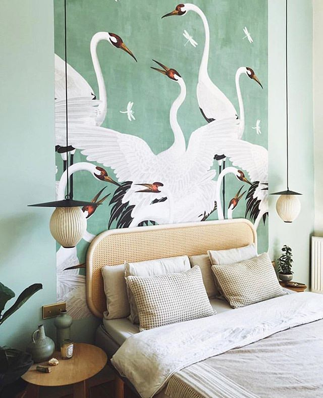"Nothing says ""refreshing"" like a cool mint wallpaper with an avian motif! Along with the light fixtures and wicker headboard, the bedroom achieves a sophisticated, natural environment. #interiordesign #wallpaper #bedroom #headboard #gucci #mint ⠀⠀⠀⠀⠀⠀⠀⠀⠀⠀⠀ #repost: @lonnymag Go to bed but make it @gucci. 👀🌱 // @timlabenda's minty fresh bedroom set-up is flawless. // Design by @timlabenda. // Wallpaper by @gucci."