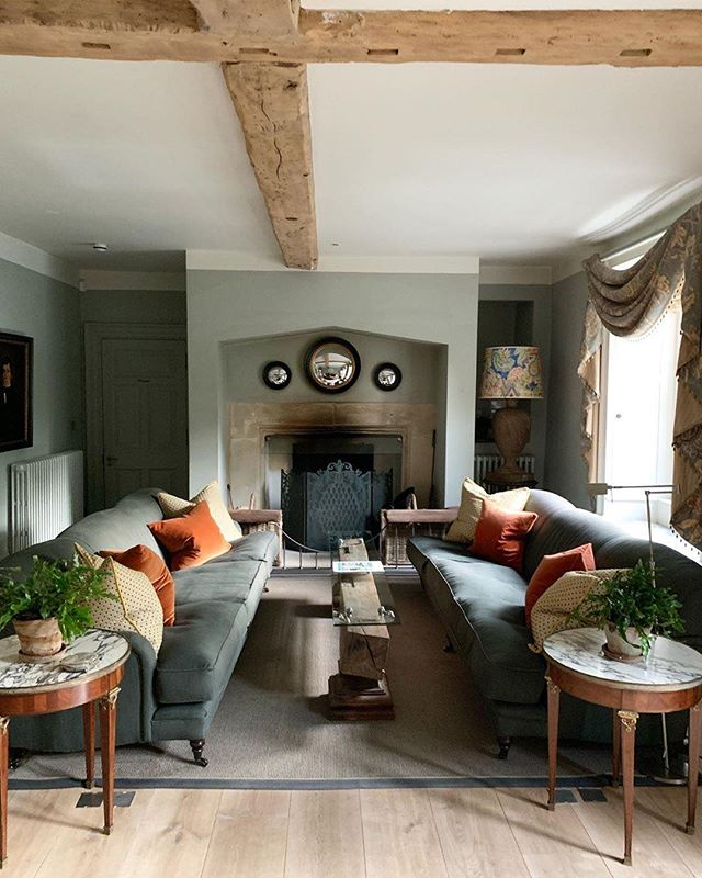 Cozy living room vibes made possible by cushiony sofas with plenty of pillows for good measure. The chrome orb inserts above the fireplace add an eccentric flair that makes the space all the more unique.  #interiordesign #decor #home #hotel #livingroom #design ⠀⠀⠀⠀⠀⠀⠀⠀⠀⠀⠀ #repost: @cococozy English sitting room in the Cotswolds.  Loved visiting this countryside hotel in the UK last week @thyme.england .  Will put together a video tour of the property.  Owned by a woman named Caryn and her husband @caryn.thyme @jerryhib.  They have created a weekend retreat that is so nice.  Went on a girls trip with my good friend who lives in the UK.  We had a blast.  The property has several buildings that are basically old homes that have been converted into a hotel lodging.  Loved loved loved this living room in our farmhouse building.  Full of charm!  I want to go back.  Are you ready for fall or are you longing for summer?  Oh btw! Thanks to my friend @manonreuter1 who is a exceptional luxury travel agent...she found us this hotel last minute! 📷: @cococozy .