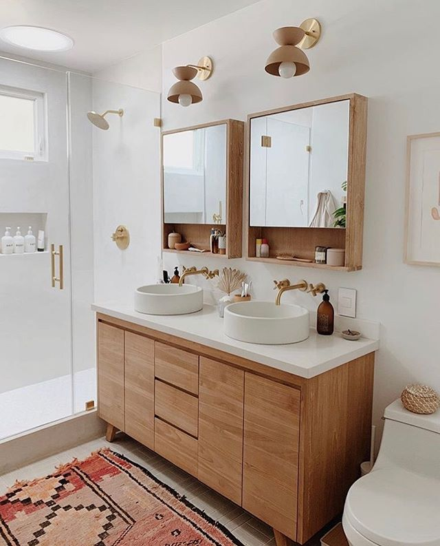 I love this bathroom's sleek and symmetrical double vanity. The light wood and beige fixtures are tastefully complimented by the rug's red and pink tones. Beauty and comfort! #repost: @almostmakesperfect  #interiordesign #decor #home #bathroom #vanity