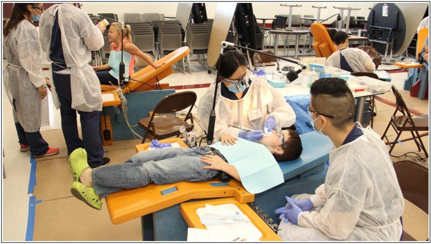 A USC School of Dentistry resident treats a Taft City School District student as part of a free mobile dental clinic made possible by a CTA partnership.