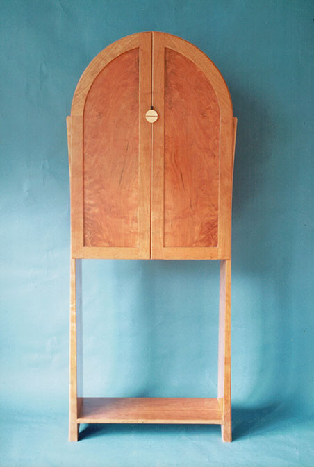 Arch-top cabinet, cherry.