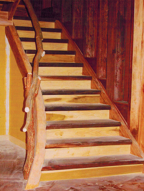 Stairs with curved stringer, cherry, walnut & poplar.