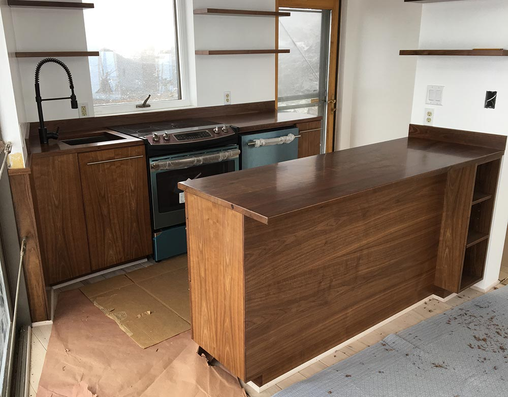 Compact kitchen, walnut.