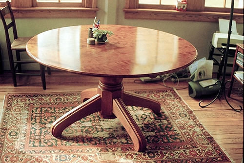 Round pedestal table, quilted cherry.