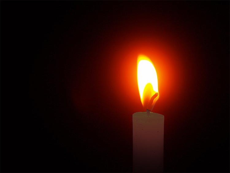 candle-light-piercing-the-dark.jpg