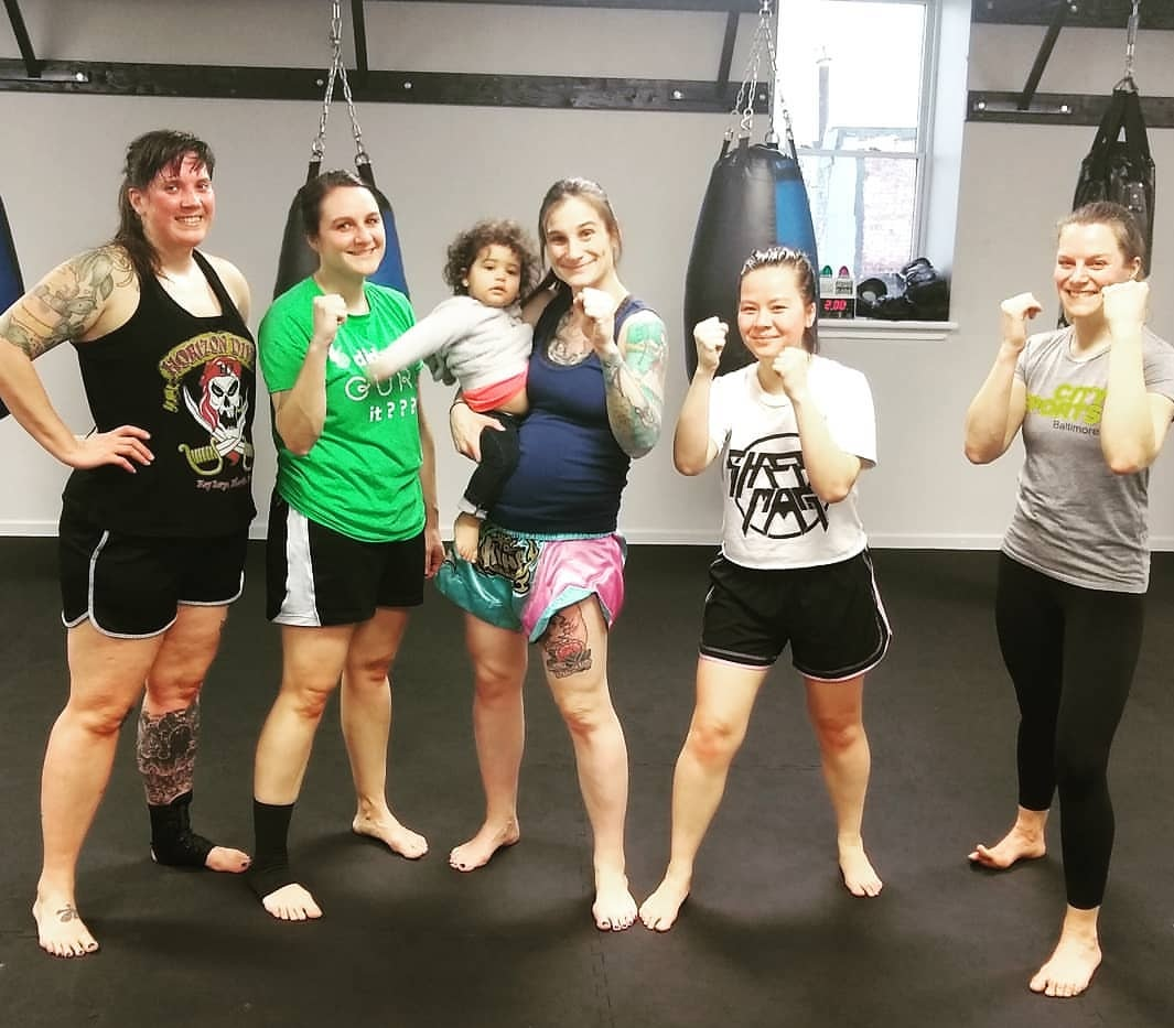 Coach Casey, with her steadfast assistant Toby, alongside some of our WKB students