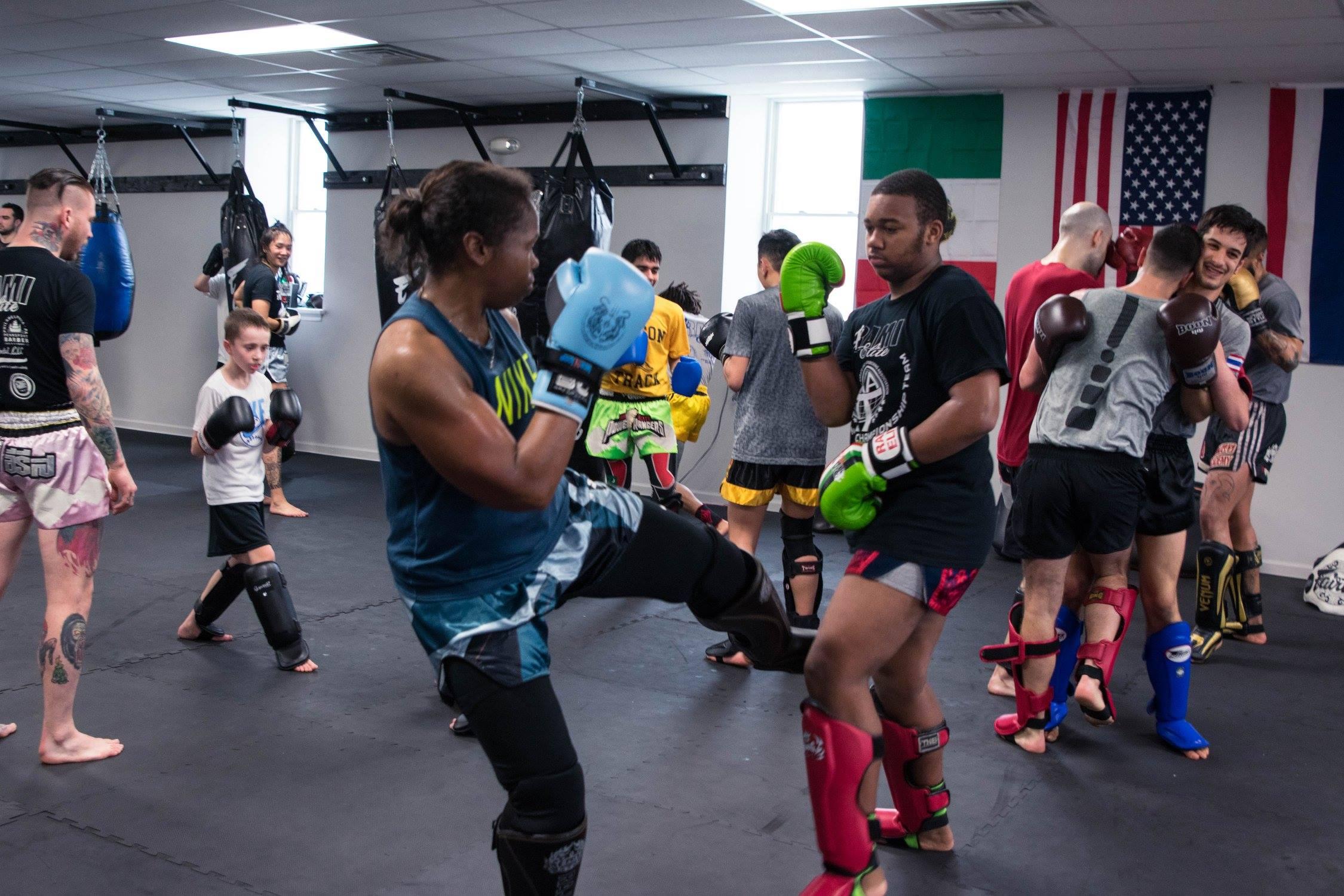 Drilling Muay Thai technique.