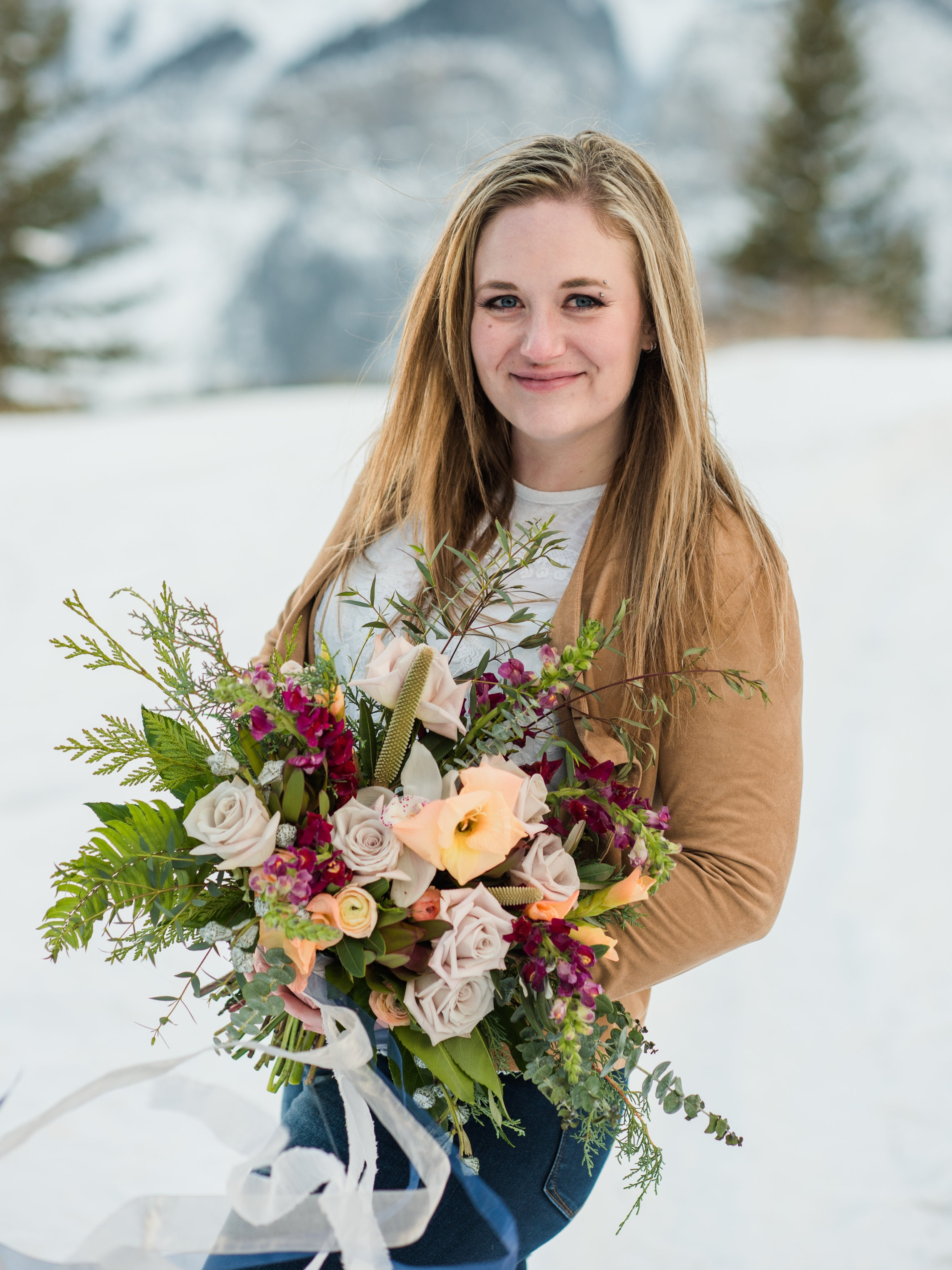 Hi, I'm Fawna! - Perfect name for a florist, am I right?! All kidding aside, I love what I do and I can't wait to work with you!I started my floral career as the owner and operator of Lilac & Lace in Innisfail but it didn't take long to realize that my true passion was wedding design. Plus… the mountains were calling! I am beyond excited to be serving this little slice of paradise known as the Bow Valley!My personal style is very woodsy and laid back, but whether you're a boho bride with a gypsy soul our an uptown sophisticate I'd love to help you make your floral dreams a reality.