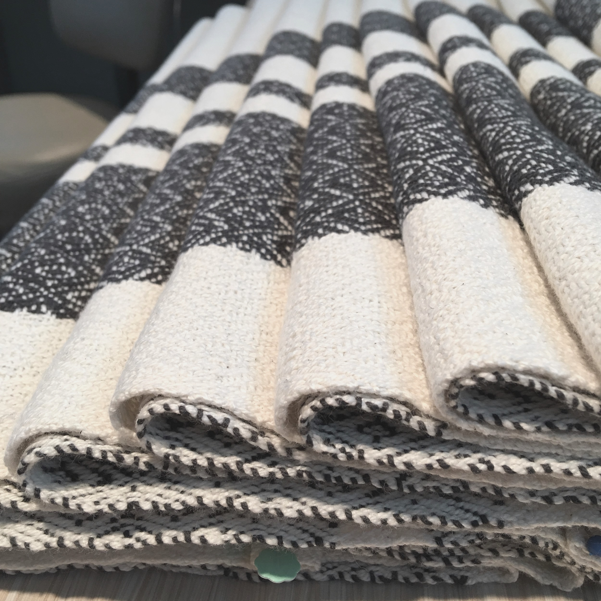 Final Finishing…. - Pressing, pinning and lots of steam….. Machine stitched hems, the only mechanized step used through the whole process. These towels are hard at work in your home, so we believe machine stitching is the best type of hemming to ensure longevity.