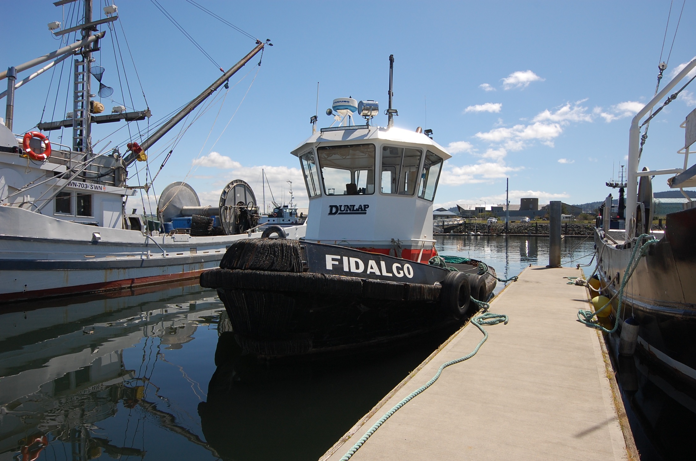 Boat at a dock with the word Fidalgo written on the side