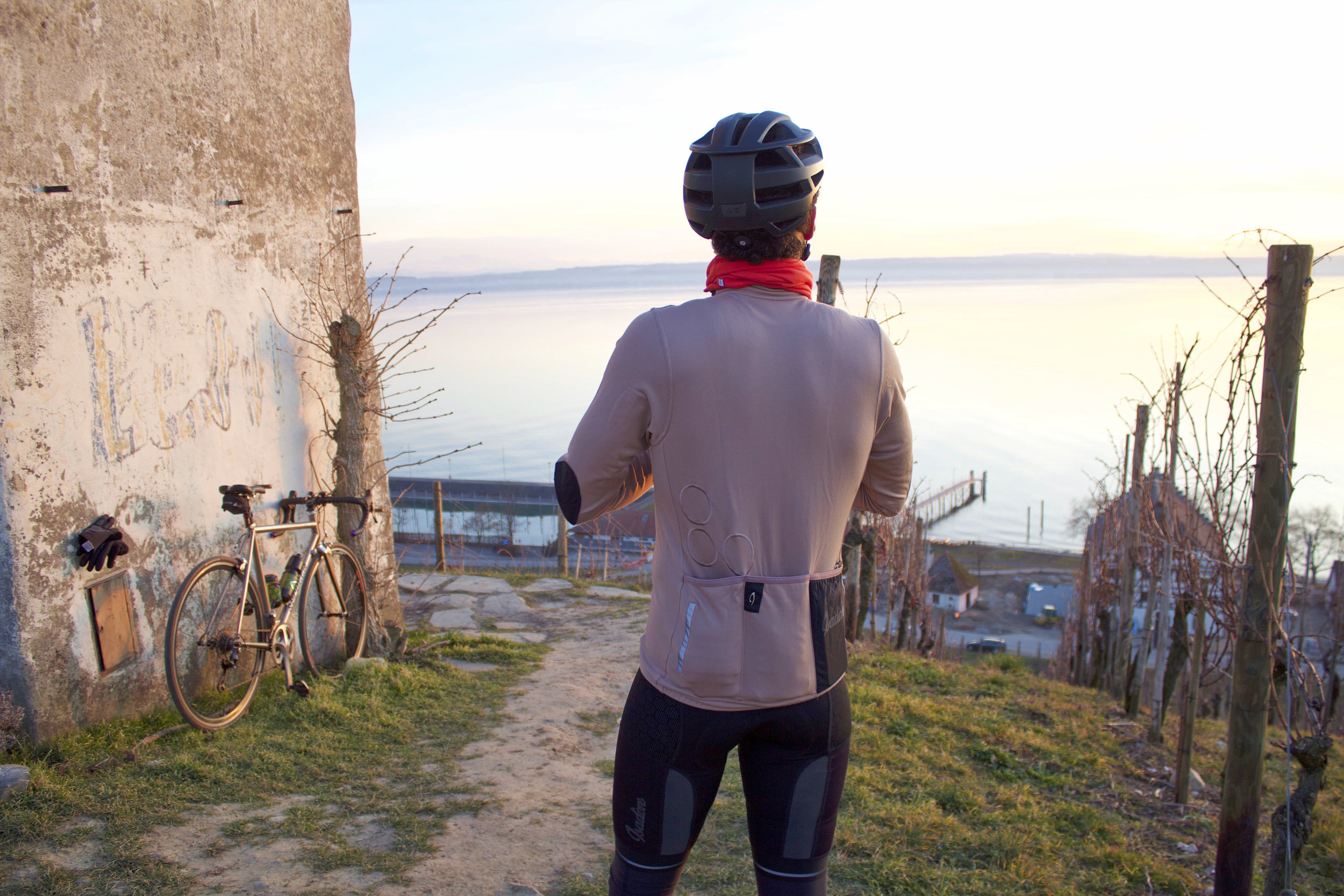 mitch looking over lake konstanz in isadore apparel cycling kit