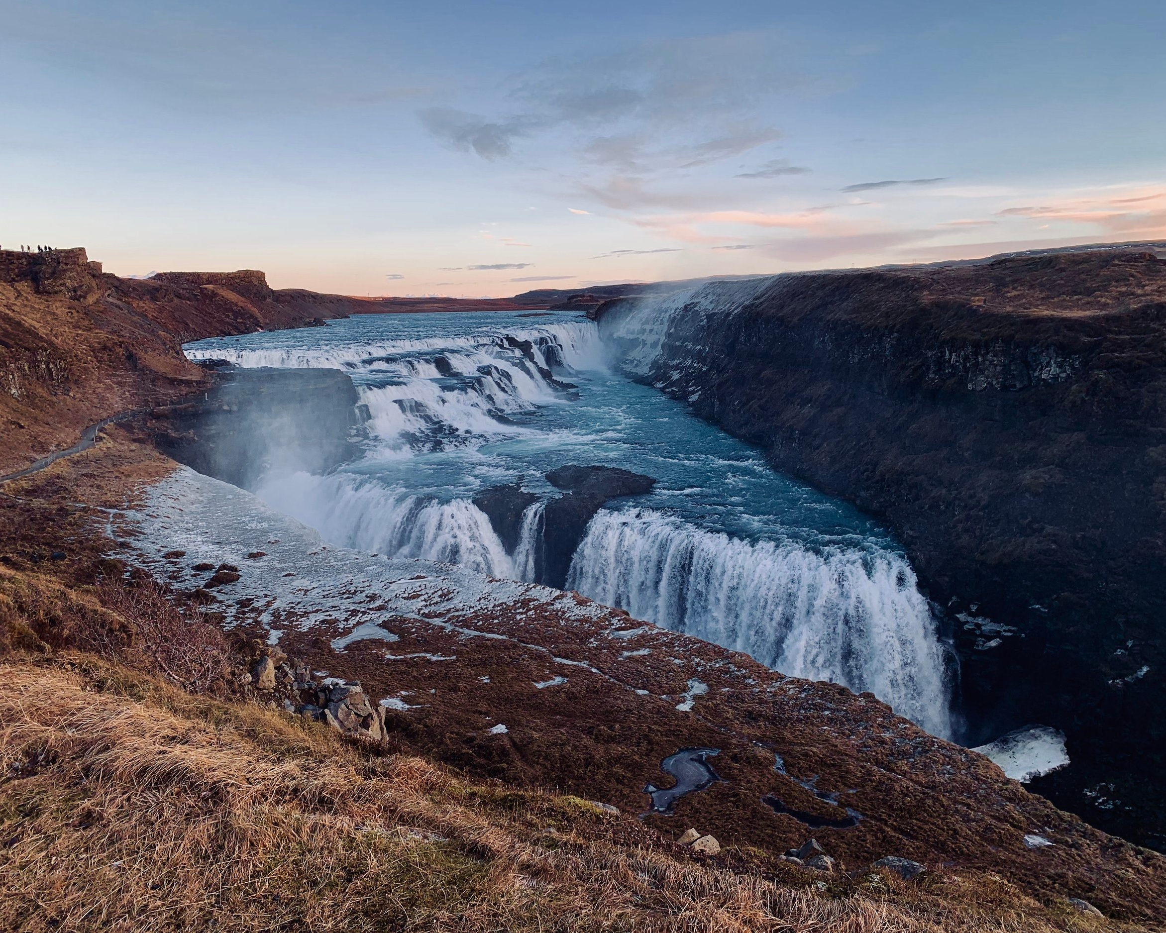 Photo of Gulfoss in warmer months courtesy of Unsplash