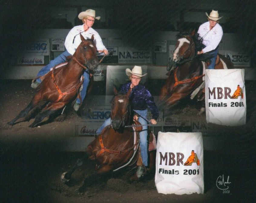 Cathy competing on DAC raised horses at the 2009 MBRA Finals. On the left is our stallion Double Jac Moon.
