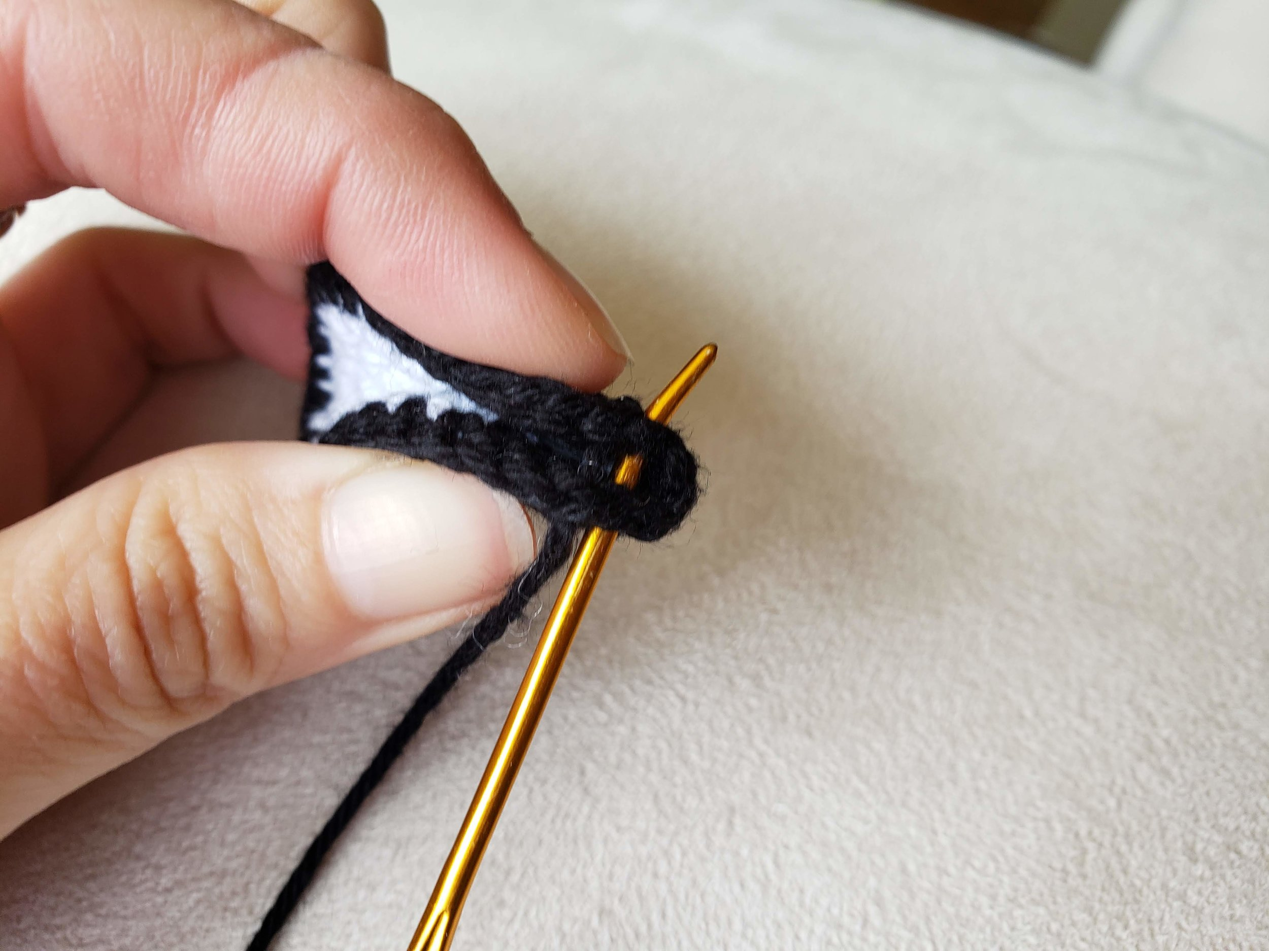 Secure the pinch by sewing the pinched end together