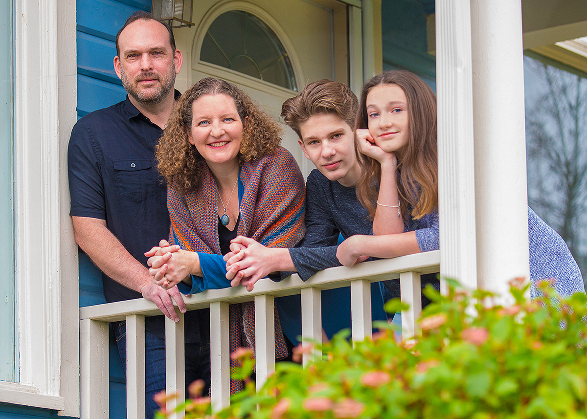 Megan and her family on the porch of their historic home!