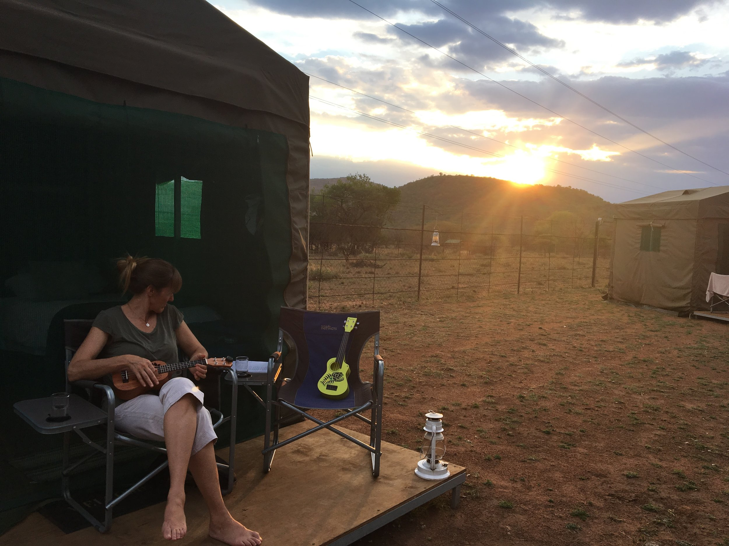 ukulele at sunset at the tented camp outside the park.JPG