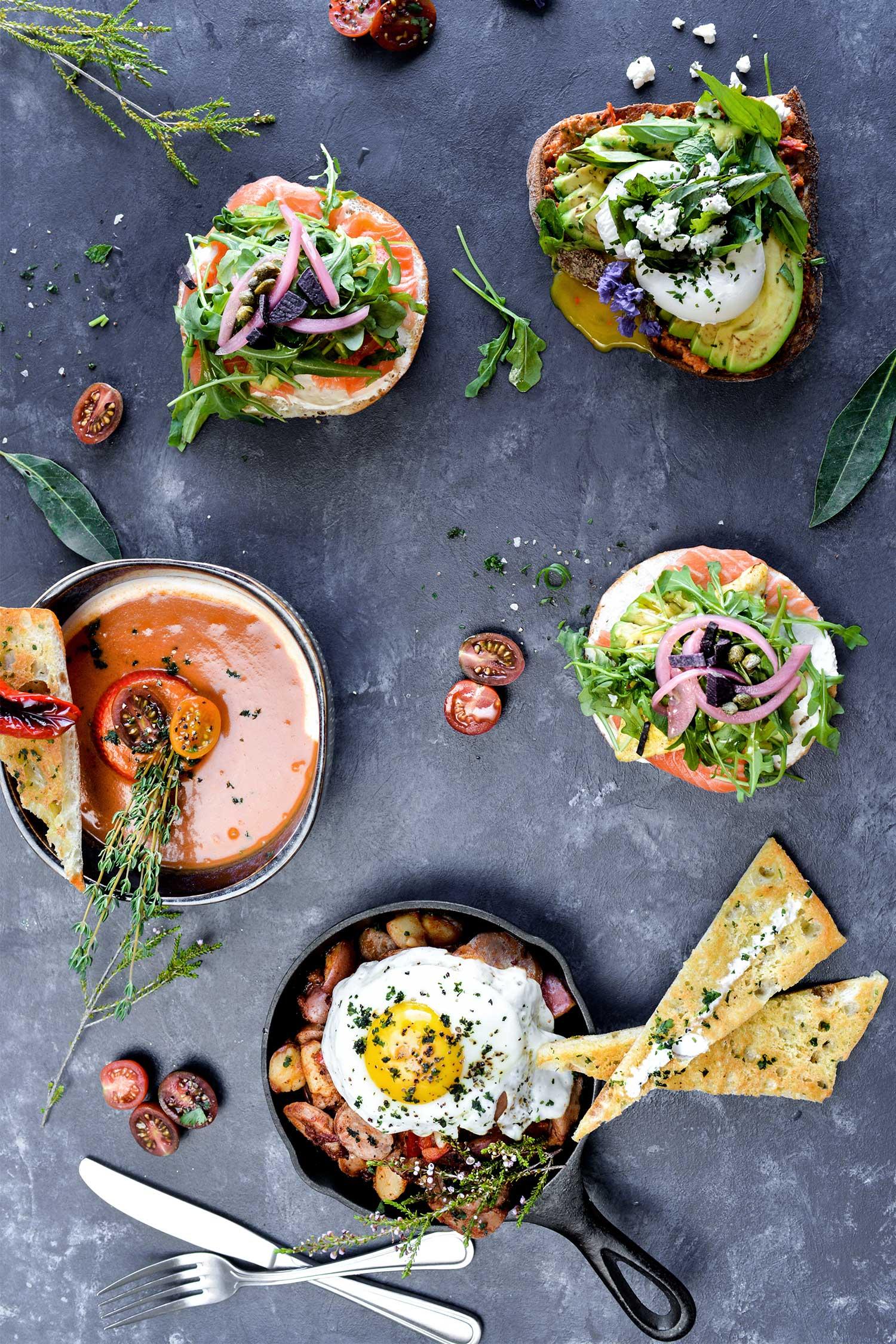 Various dishes - avocado toast, seasonal soup, breakfast skillet, bagel and lox