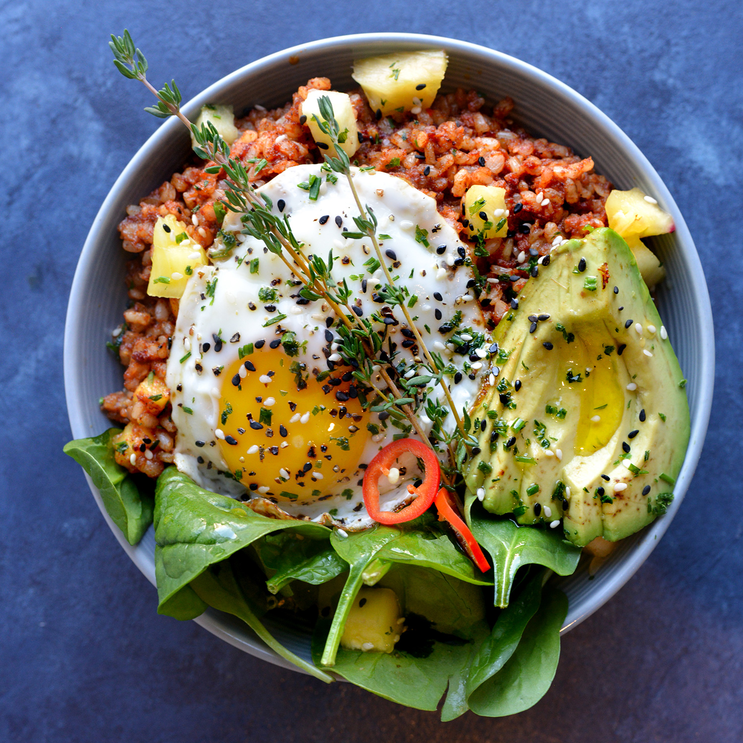 HAWAIIAN BOWL - Pineapple, Chorizo, brown rice, spinach, cilantro, topped with a sunny side egg and avocado