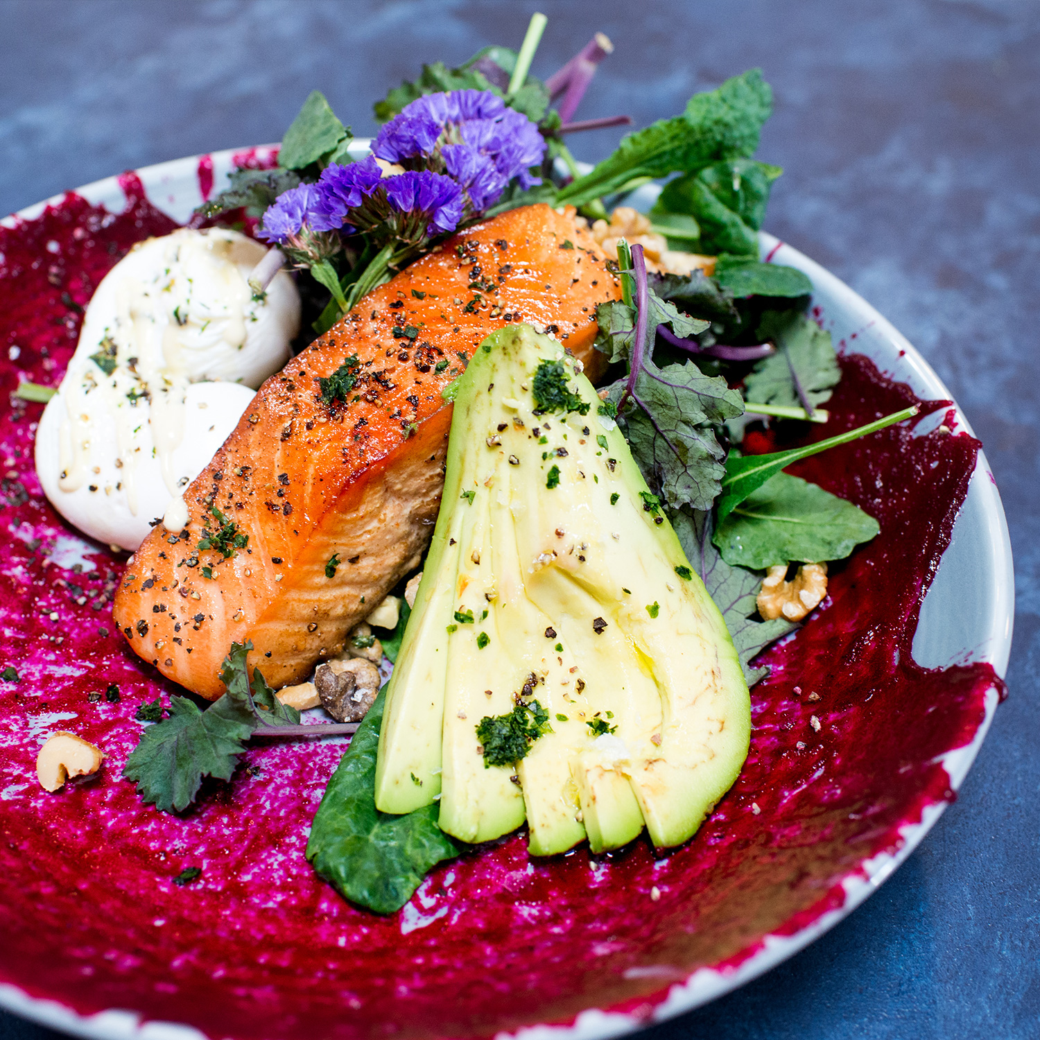 HOUSE SMOKED SALM0N - beetroot puree splash, shaved kale, roasted walnuts, avocado, poached eggs topped with house mustard aioli