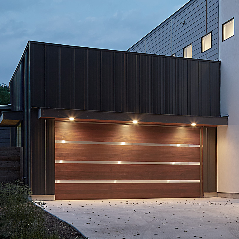 Garage Doors - We build custom wood and metal garage doors of all styles and sizes and provide premium manufactured steel and aluminum garage doors.