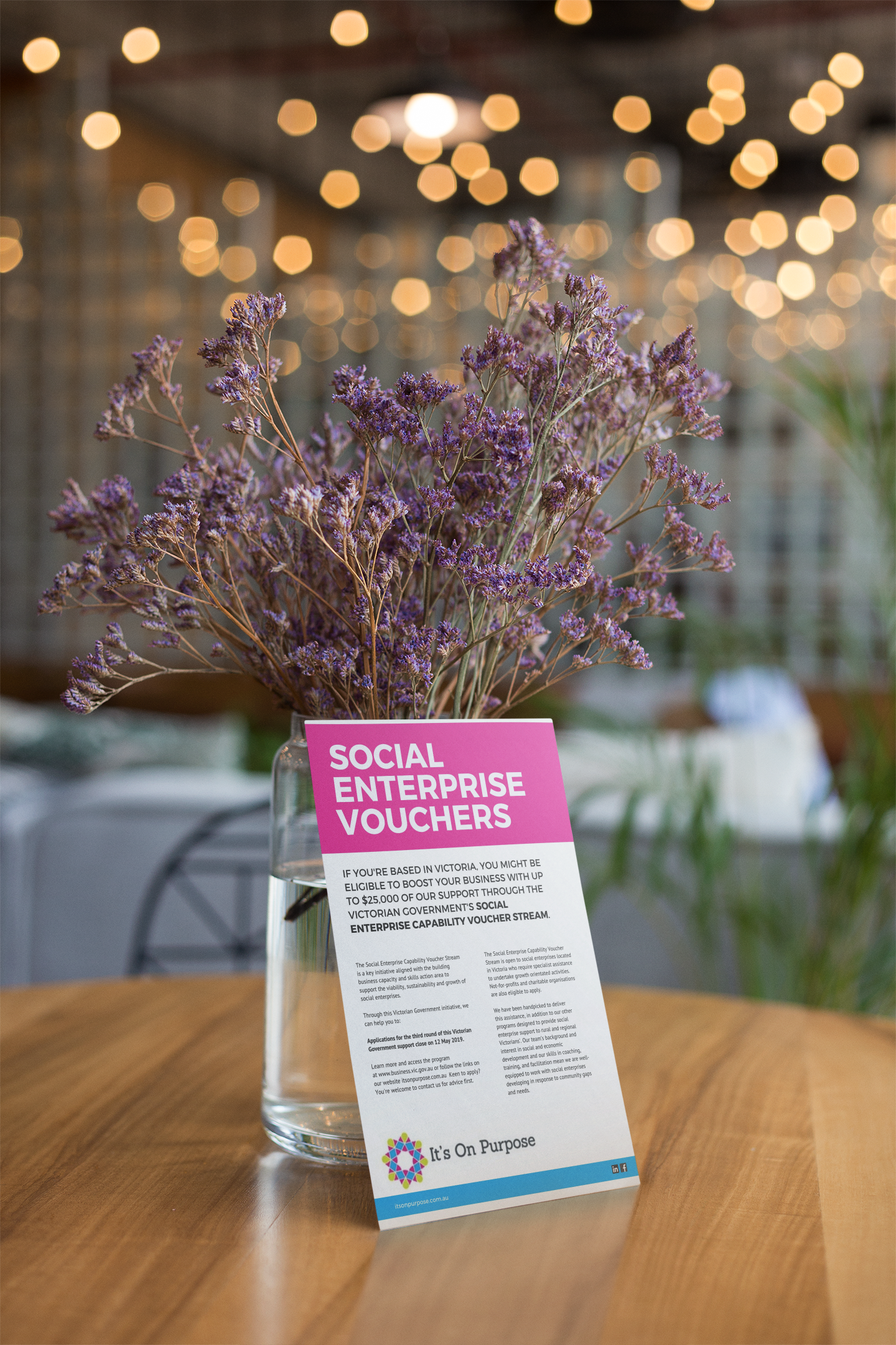 flyer-mockup-leaning-against-a-vase-with-purple-flowers-21864.png