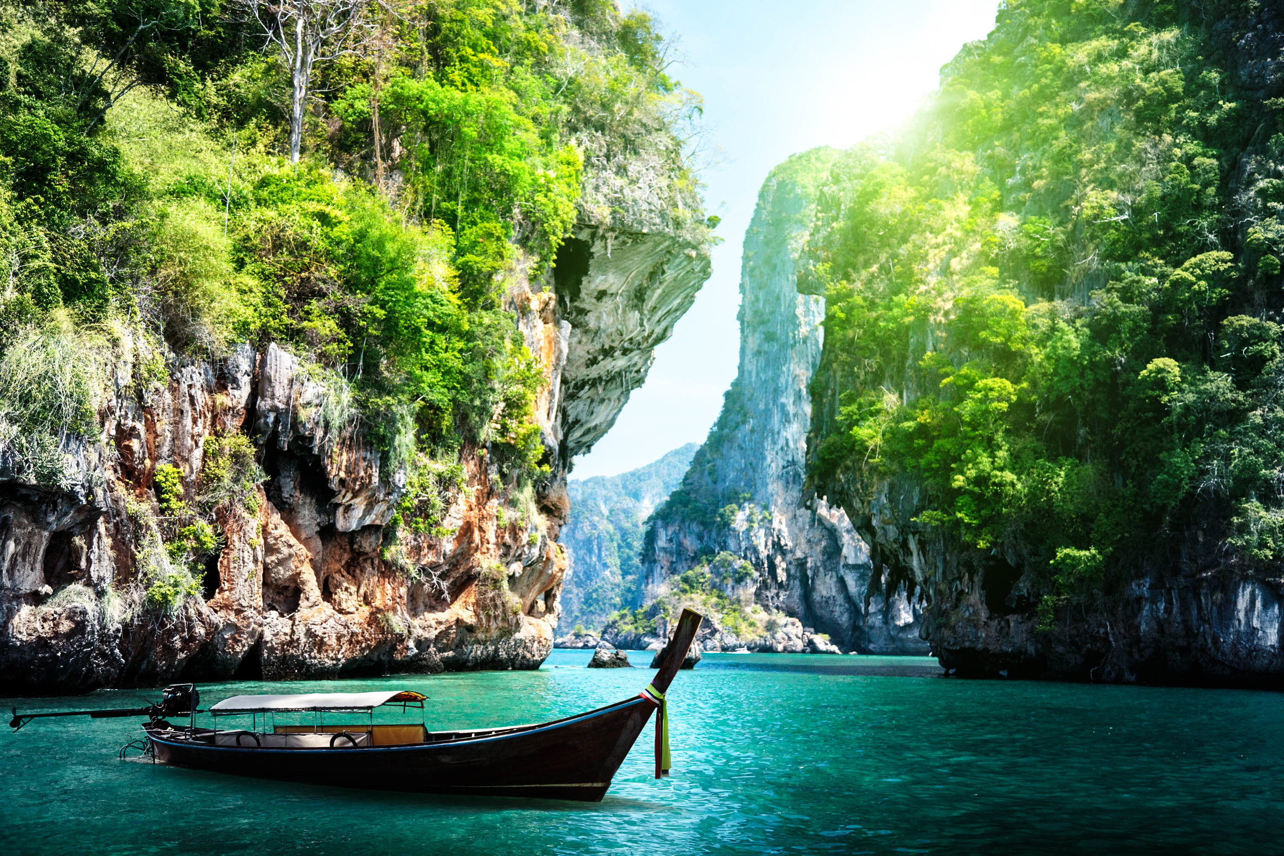 long-boat-and-rocks-on-railay-beach-in-Krabi-Thailand-shutterstock_125319602-2.jpg