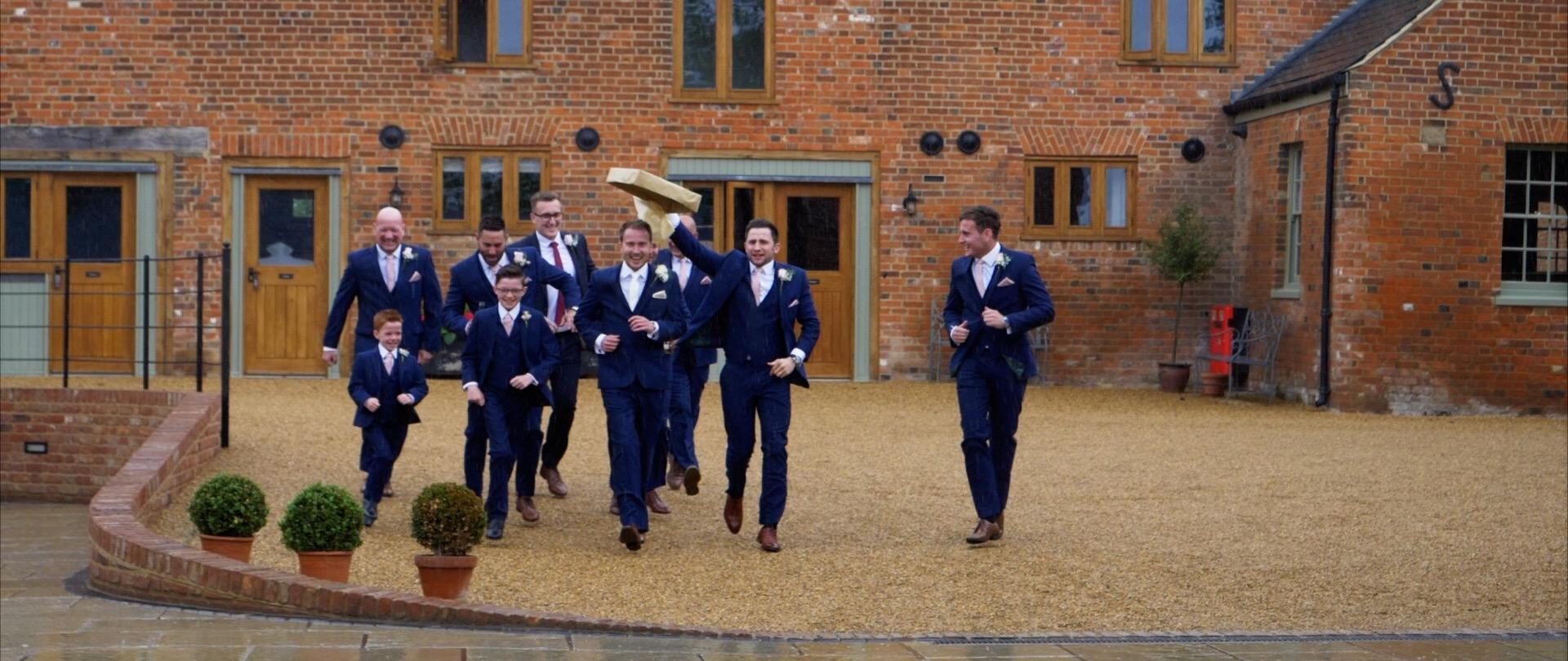 Running in the Rain at Apton Hall weddings Videogapher.jpg