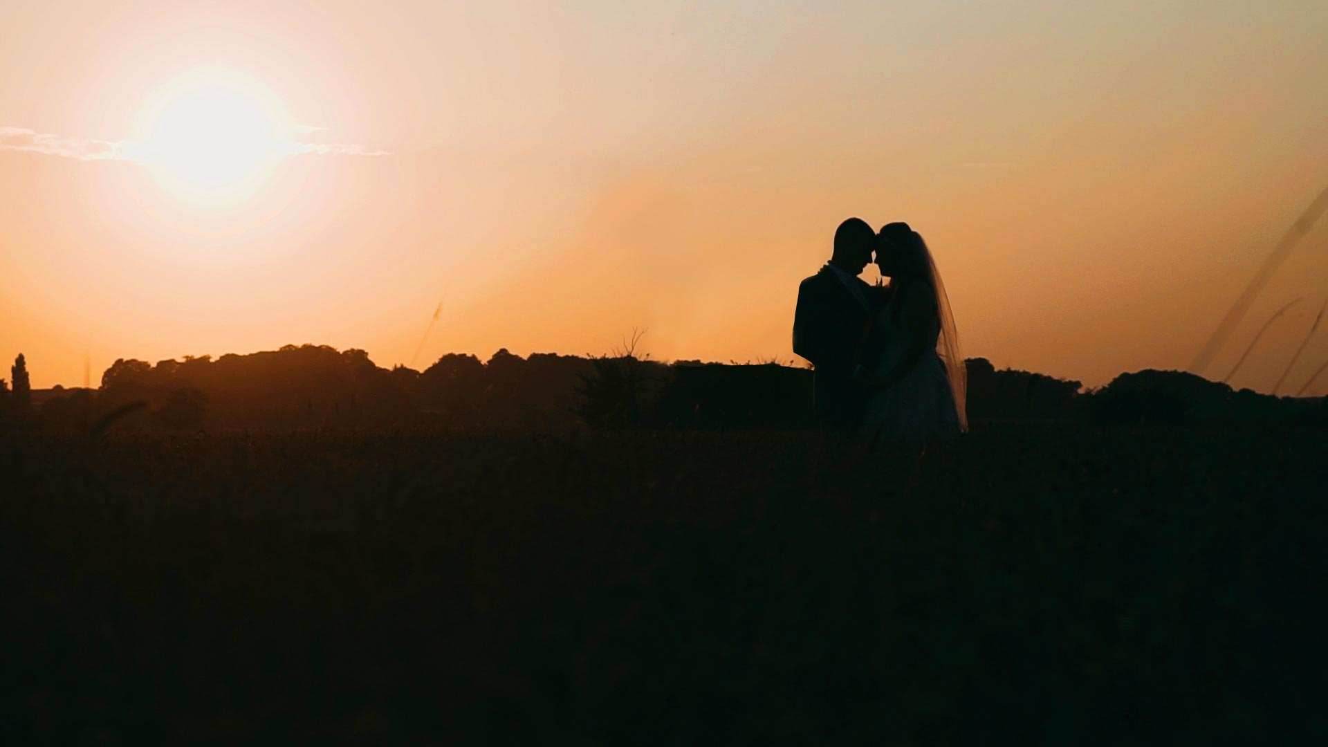 Bride-and-groom-at-sunset-cornfield-laceby-manor-golf-resort-wedding-videographer-lincolnshire-pocket-jacks-films-lincolnshire-videography.jpg