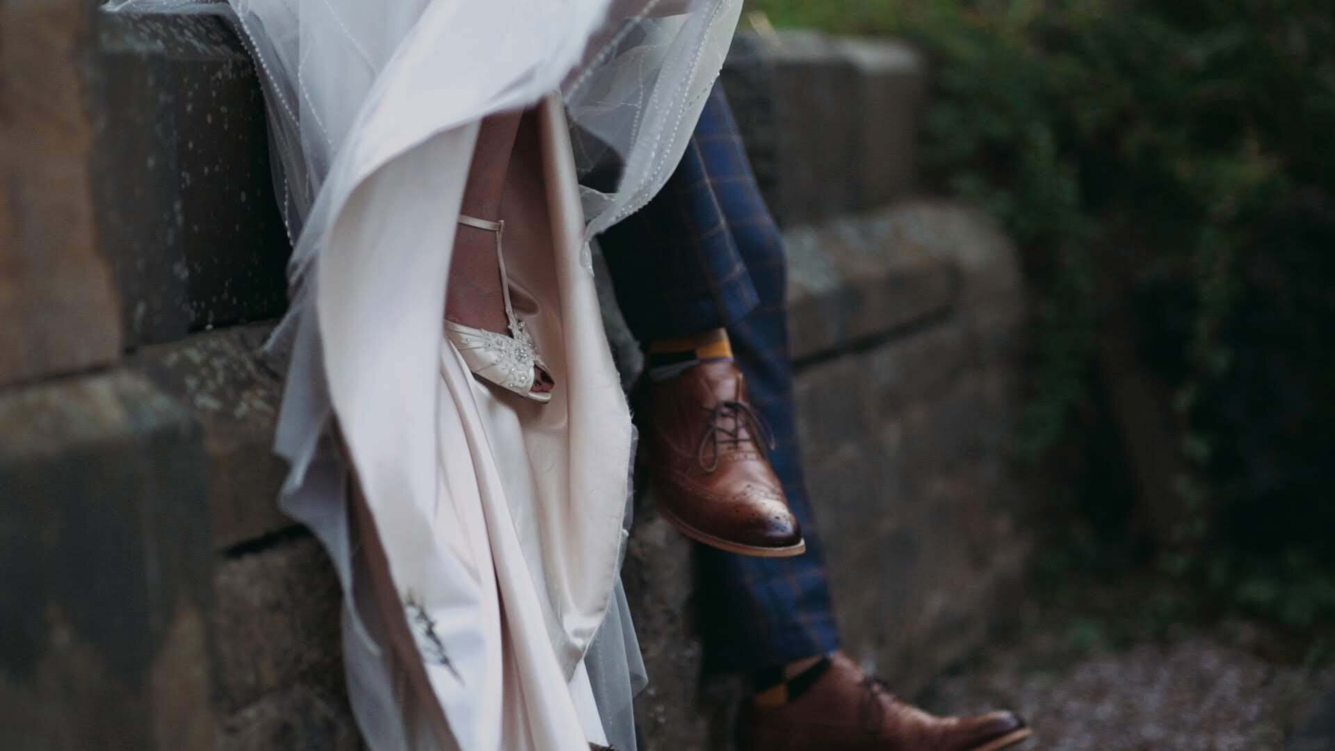 Wedding-Couple-Feet-Sitting-on-Wall-Pocket-Jacks-Films-UK-Wedding-Videographer