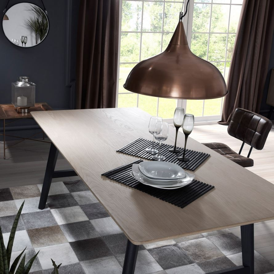 The Mastrella Henri Dining Table - £945 - The Henri Dining Table from Mastrella features a stunning finish to the top. The rounded edges of solid oak give the Henri collection a tactile feel. The legs are in a solid black oak with black metal fixings. Starting at £945 this is a luxury dining table at an affordable price.