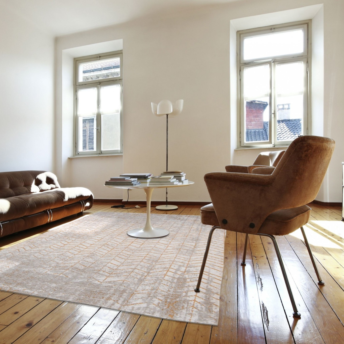 Rugs - It may not be so obvious, but dark flooring can bring a cold feel to a room that doesn't get much light. One way to combat this, other than replacing your flooring, is to place a large light coloured rug on the floor, this is a great way to instantly make a room feel brighter.