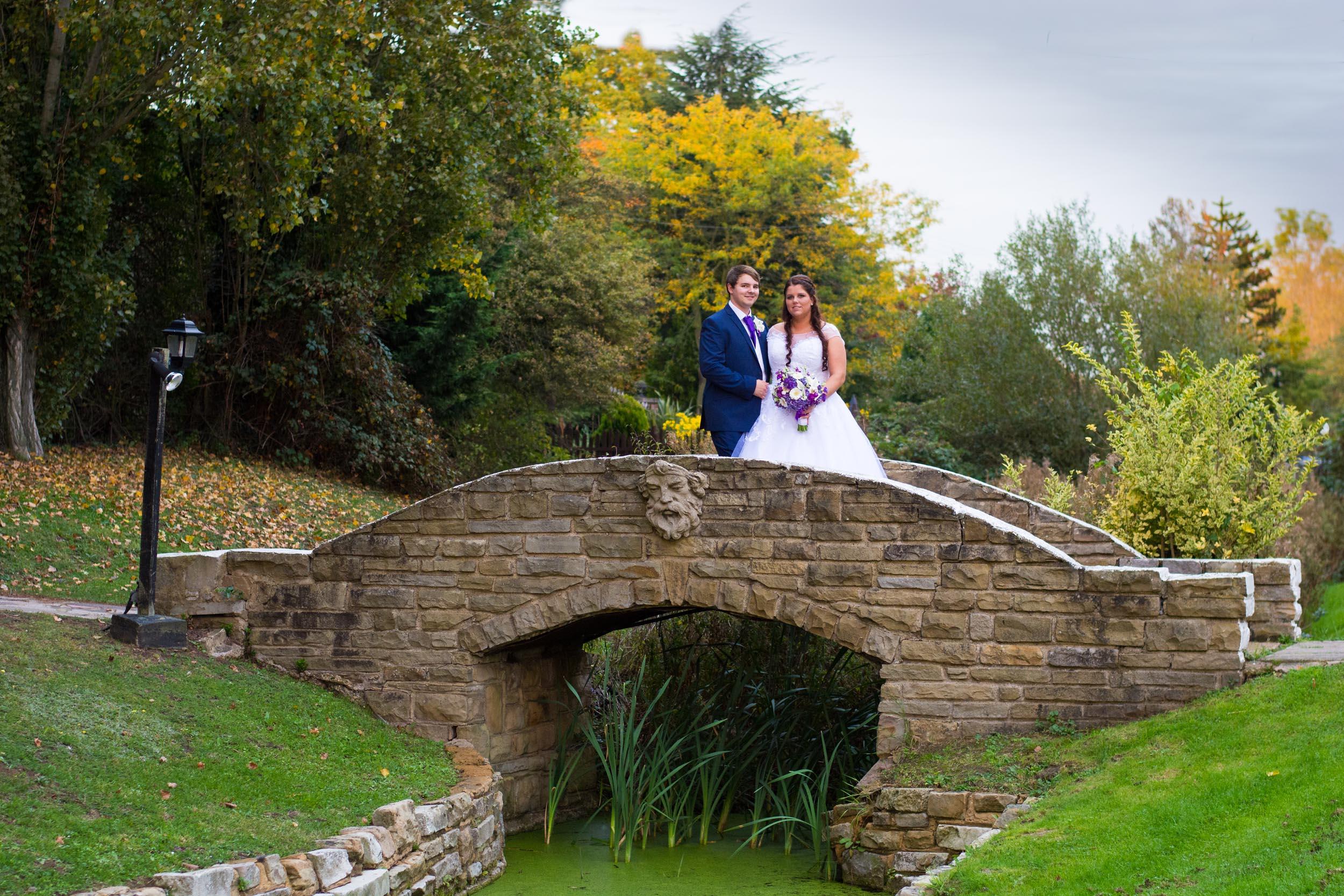 Ye Olde Plough House Bridge with wedding couple