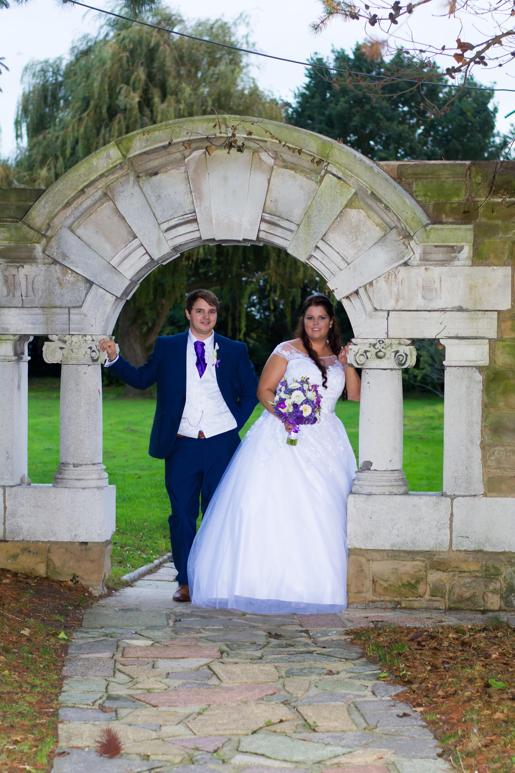 Ye Olde Plough House with bride and groom under one of the arches