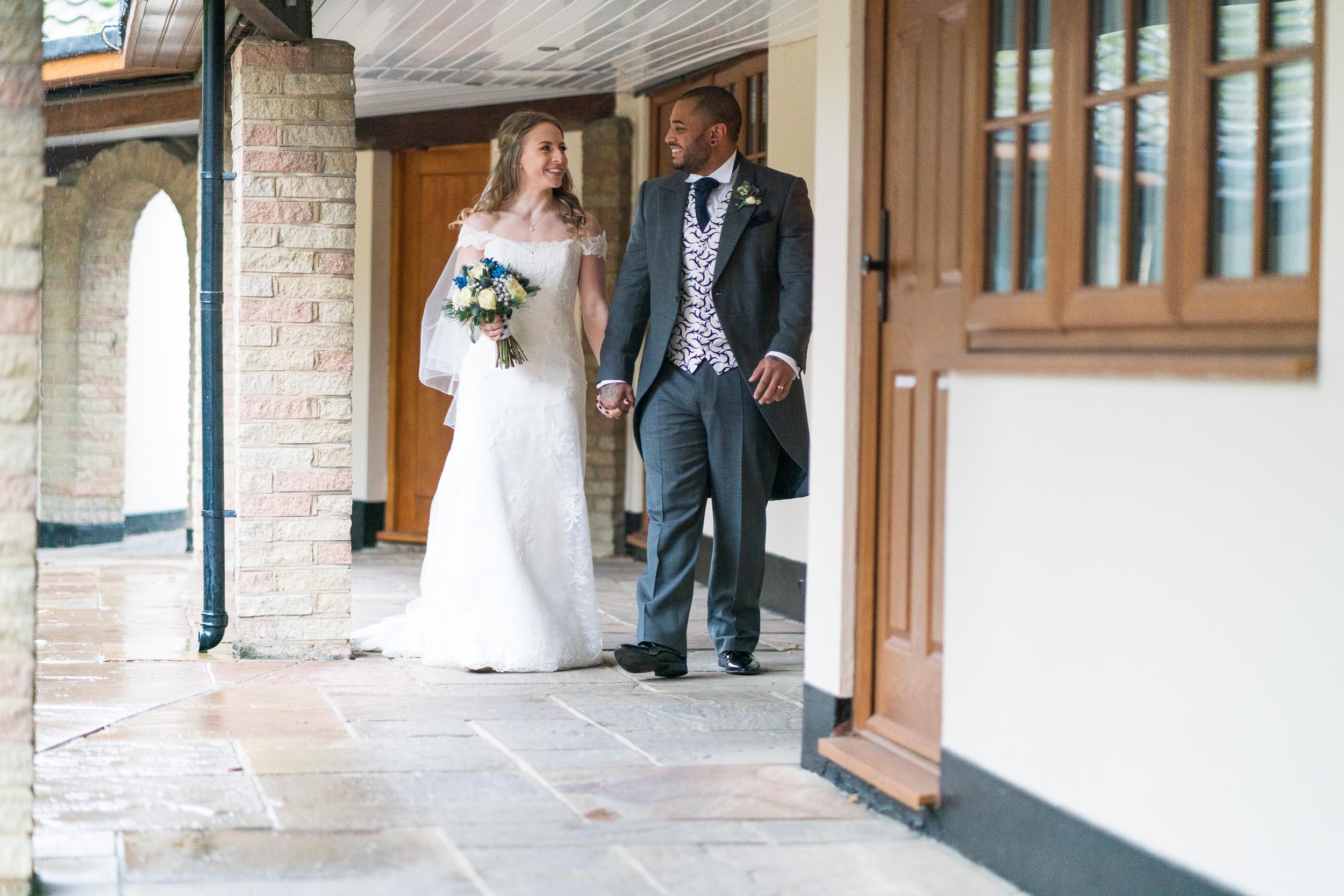 Ye Olde Plough House bride and groom walking