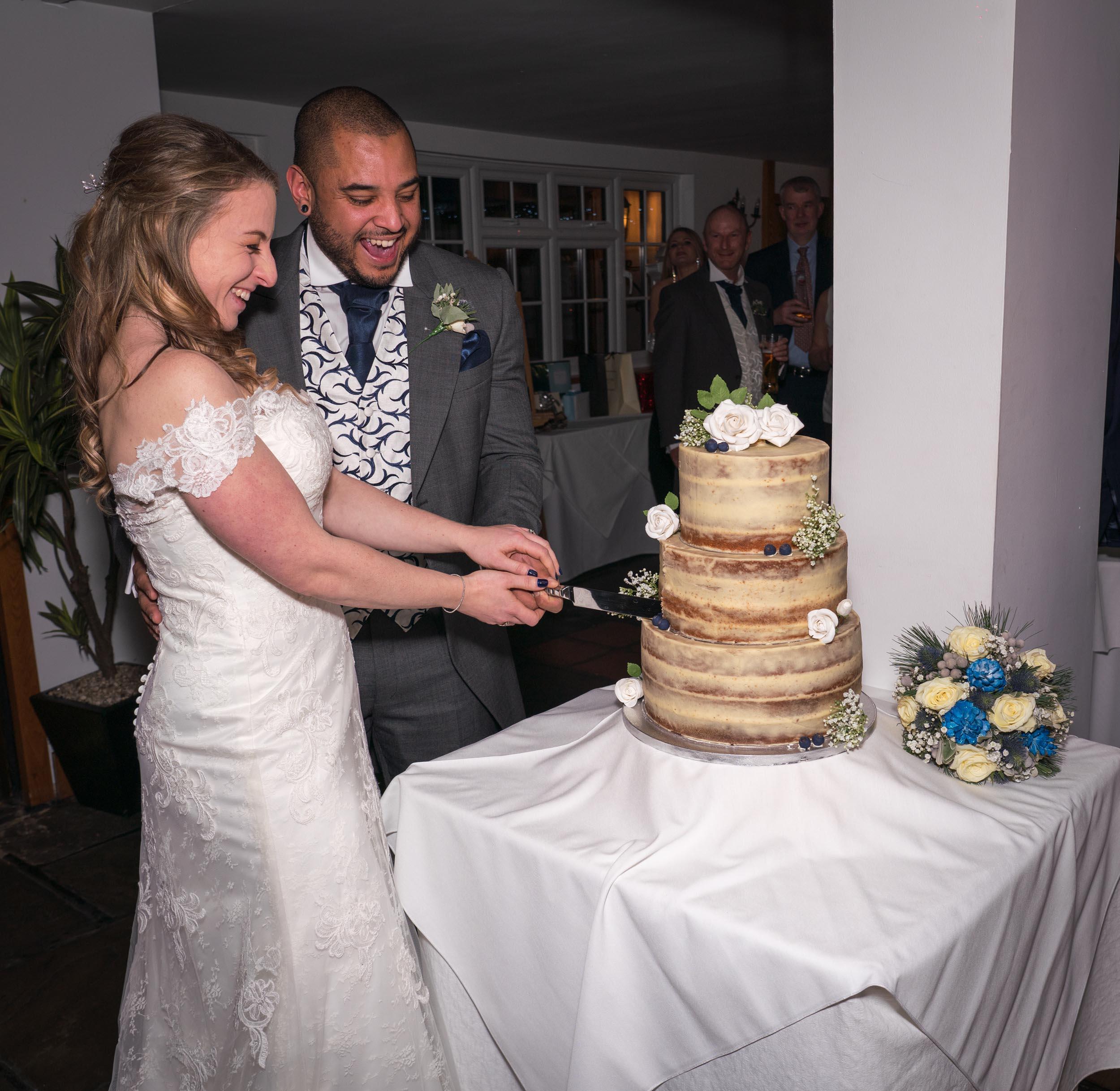 Ye Olde Plough House cutting the cake